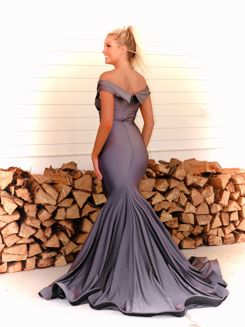 Back of Model turning every head in this fit and flare off the shoulder red evening gown! And it's at Rsvp Prom and Pageant, your source for the HOTTEST prom and pageant dresses and exclusive evening gowns and located in Atlanta Georgia!