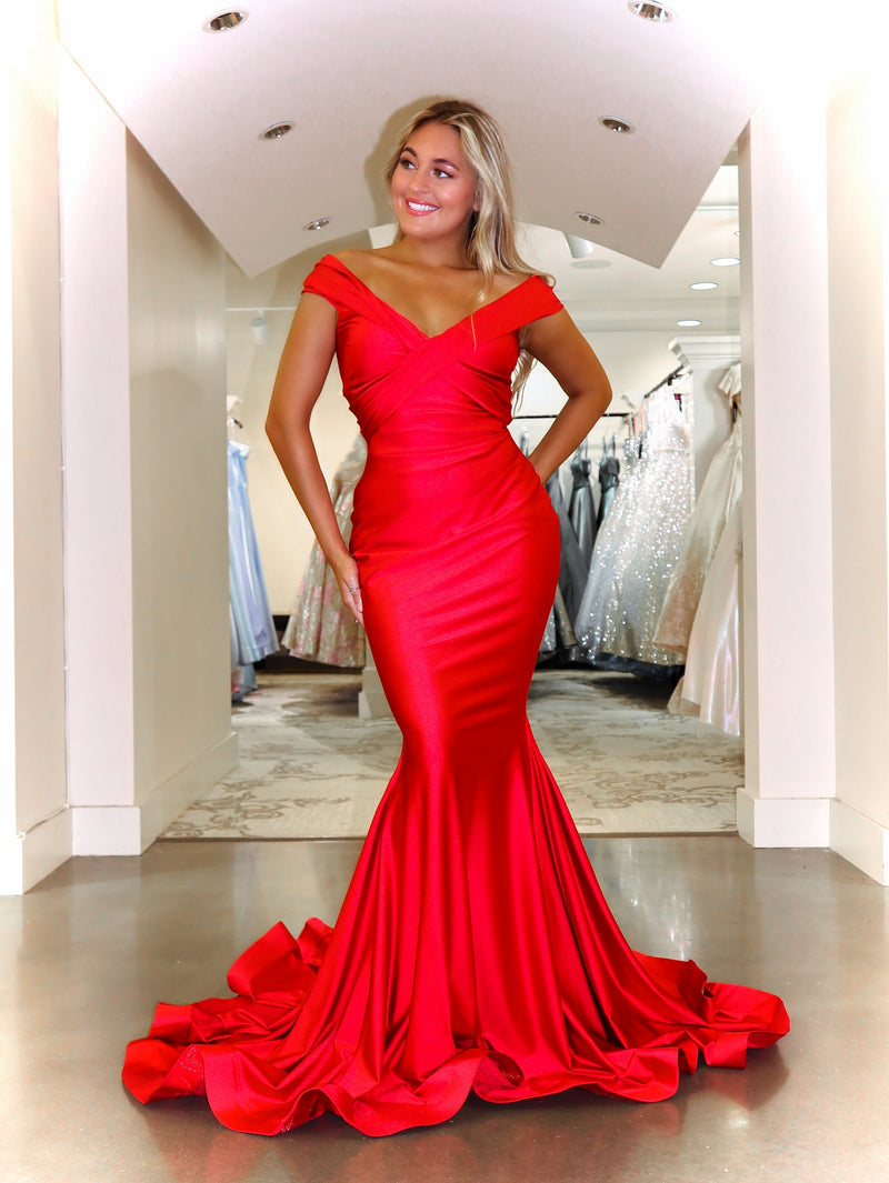model in this fit and flare off the shoulder red evening gown! And it's at Rsvp Prom and Pageant, your source for the HOTTEST prom and pageant dresses and exclusive evening gowns and located in Atlanta Georgia!