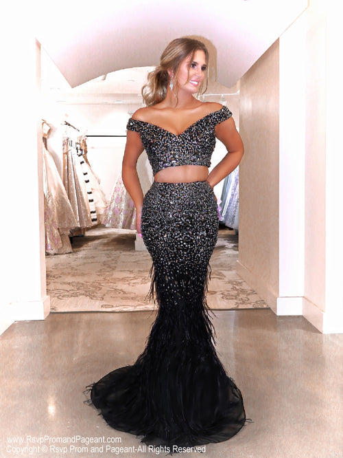 Model in a glamorous black two piece sparkling from head to toe completely covered with sequins. The feathers on the skirt give it an even more sophisticated look! And it's at Rsvp Prom and Pageant, your source for the HOTTEST Prom and Pageant Dresses and exclusive evening gowns and located in Atlanta, Georgia!