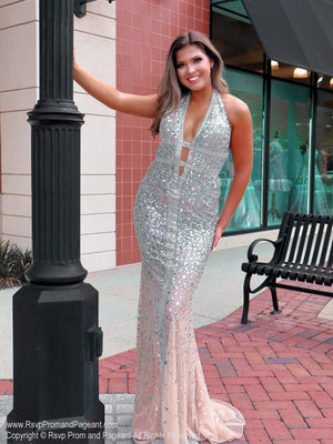 Brunette in Talk about a show stopper!! No doubt, you will wow the crowd in this gorgeous evening fully detailed with iridescent stones! It also features a low cut back and a halter neckline! And it's at Rsvp Prom and Pageant, your source for the HOTTEST Prom, Pageant and evening gowns, Atlanta, Georgia!