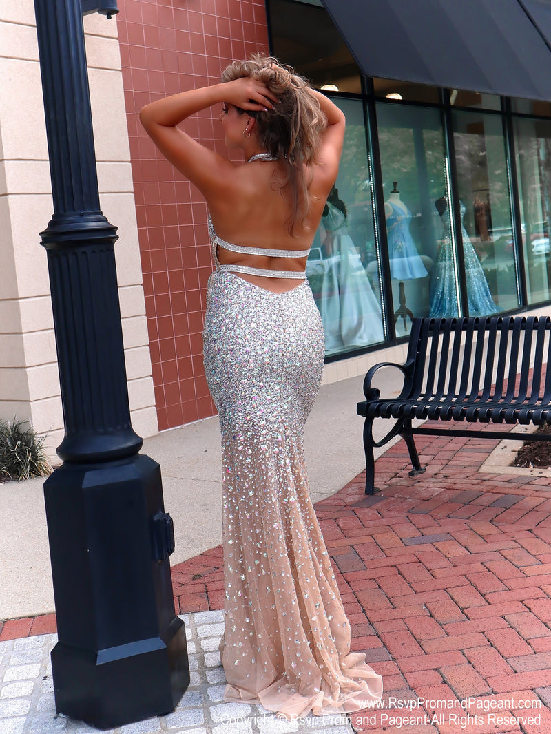 Back of Talk about a show stopper!! No doubt, you will wow the crowd in this gorgeous evening fully detailed with iridescent stones! It also features a low cut back and a halter neckline! And it's at Rsvp Prom and Pageant, your source for the HOTTEST Prom, Pageant and evening gowns, Atlanta, Georgia!