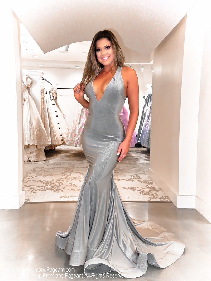 Model in this silver, open back, plunging v-neck, fit and flare Prom Dress which is an absolute must-have for Prom this year! And its at RSVP Prom and Pageant, your source for the HOTTEST Prom and Pageant Dresses and exclusive evening gowns and located in Atlanta, Georgia!