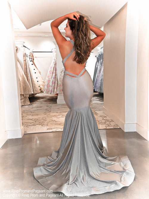 Back of Model in this silver, open back, plunging v-neck, fit and flare Prom Dress which is an absolute must-have for Prom this year! And its at RSVP Prom and Pageant, your source for the HOTTEST Prom and Pageant Dresses and exclusive evening gowns and located in Atlanta, Georgia!