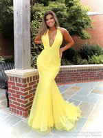 Model looking stunning in this yellow fit and flare gown! It has a plunging v neckline and low cut back, which makes this dress perfect for prom! And it's at Rsvp Prom and Pageant, your source for the HOTTEST Prom and Pageant Dresses and exclusive evening gowns and located in Atlanta, Georgia!