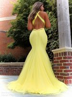 Back of model looking stunning in this yellow fit and flare gown! It has a plunging v neckline and low cut back, which makes this dress perfect for prom! And it's at Rsvp Prom and Pageant, your source for the HOTTEST Prom and Pageant Dresses and exclusive evening gowns and located in Atlanta, Georgia!