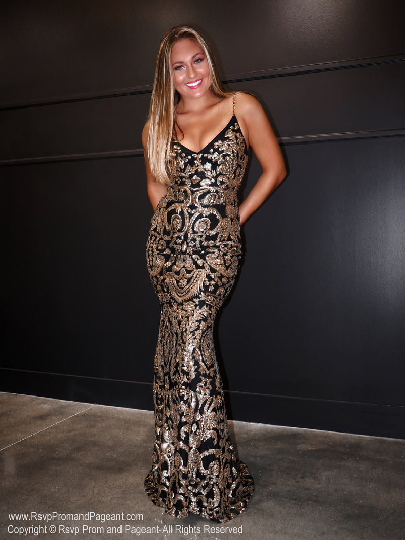 Model in a gorgeous Black and Gold, sequined, sweetheart neckline Prom Dress with an absolute must-see embellished back! And its at RSVP Prom and Pageant, your source for the HOTTEST Prom and Pageant Dresses and exclusive evening gowns and located in Atlanta, Georgia!