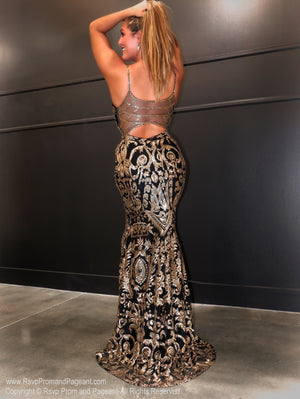 Back of model in a gorgeous Black and Gold, sequined, sweetheart neckline Prom Dress with an absolute must-see embellished back! And its at RSVP Prom and Pageant, your source for the HOTTEST Prom and Pageant Dresses and exclusive evening gowns and located in Atlanta, Georgia!