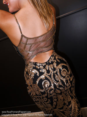 Closeup of back of model in a gorgeous Black and Gold, sequined, sweetheart neckline Prom Dress with an absolute must-see embellished back! And its at RSVP Prom and Pageant, your source for the HOTTEST Prom and Pageant Dresses and exclusive evening gowns and located in Atlanta, Georgia!