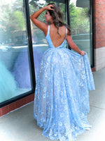 Back of Model in this glamourous ball gown dress sparkling all night with the sequin floral print on the skirt. The v neckline adds the perfect touch to this dress! And it's at Rsvp Prom and Pageant, your source for the HOTTEST Prom and Pageant Dresses and Exclusive Evening Gowns and located in Atlanta, Georgia!