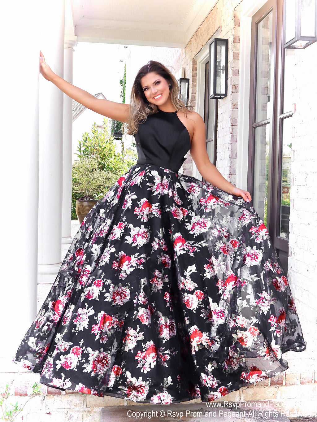 Model in in this glamorous gown with its full flowing floral skirt and which no doubt will make heads turn in this dress! And it's at Rsvp Prom and Pageant, your source for the HOTTEST Prom and Pageant Dresses and exclusive evening gowns and located in Atlanta, Georgia!