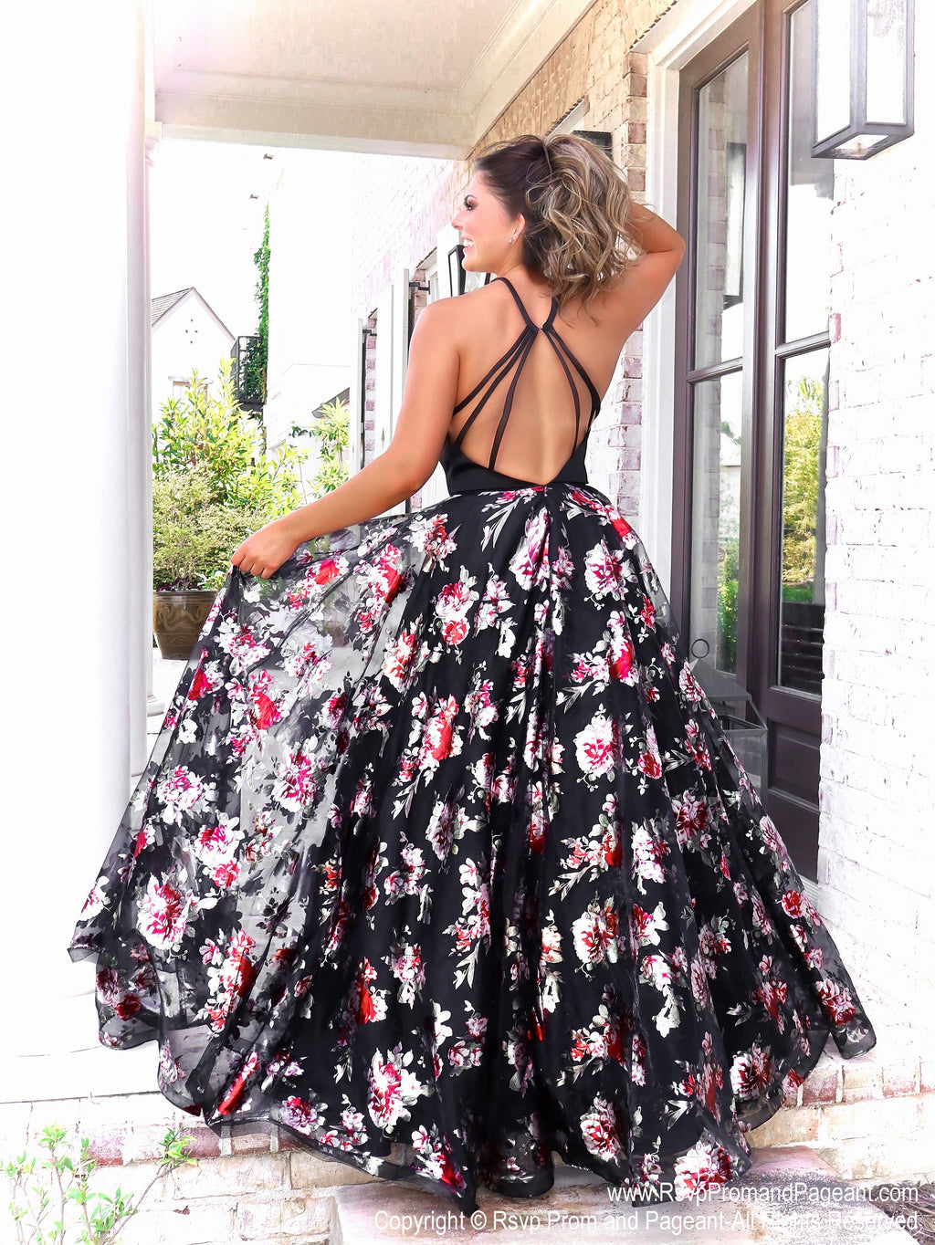 Back of Model in in this glamorous gown with its full flowing floral skirt and which no doubt will make heads turn in this dress! And it's at Rsvp Prom and Pageant, your source for the HOTTEST Prom and Pageant Dresses and exclusive evening gowns and located in Atlanta, Georgia!