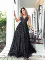 Model Stealing the show with this glamorous ball gown dress! It has a low cut open back and glitter all over! And it's at Rsvp Prom and Pageant, your source for the HOTTEST Prom and Pageant Dresses and exclusive evening gowns and located in Atlanta, Georgia!