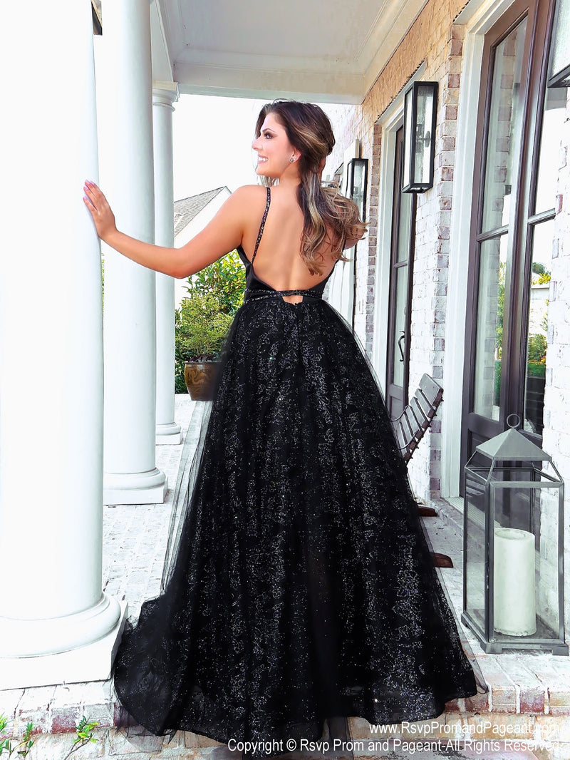 Back of Model Stealing the show with this glamorous ball gown dress! It has a low cut open back and glitter all over! And it's at Rsvp Prom and Pageant, your source for the HOTTEST Prom and Pageant Dresses and exclusive evening gowns and located in Atlanta, Georgia!