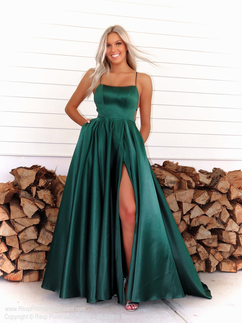 Model in a simple and elegant A-line dress which will definitely make heads turn walking through the door! And it's at Rsvp Prom and Pageant, your source for the HOTTEST Prom and Pageant Dresses and exclusive evening gowns and located in Atlanta, Georgia!