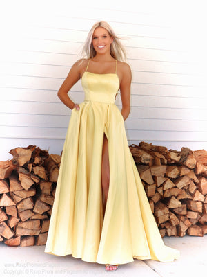 Blonde model in a simple and elegant A-line dress which will definitely make heads turn as you walk  through the door! And it's at Rsvp Prom and Pageant, your source for the HOTTEST Prom and Pageant Dresses and exclusive evening gowns and located in Atlanta, Georgia!