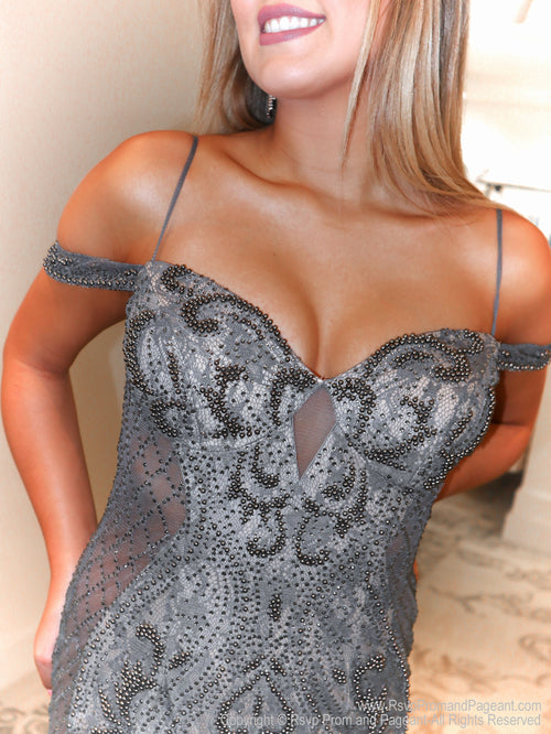Closeup of Model in a spectacular gunmetal over nude evening gown featuring illusionary clear sides without showing skin! Extremely sophisticated and elegant!  And it's at Rsvp Prom and Pageant, your source for the HOTTEST Prom and Pageant Dresses and exclusive evening gowns and located in Atlanta, Georgia!