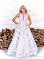 Model in the sweetest ball gown with its high neckline and a floral pattern all over the full skirt! And it's at Rsvp Prom and Pageant, your source for the HOTTEST Prom and Pageant Dresses and Exclusive Evening Gowns and located in Atlanta, Georgia!