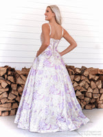 Back of model in the sweetest ball gown with its high neckline and a floral pattern all over the full skirt! And it's at Rsvp Prom and Pageant, your source for the HOTTEST Prom and Pageant Dresses and Exclusive Evening Gowns and located in Atlanta, Georgia!