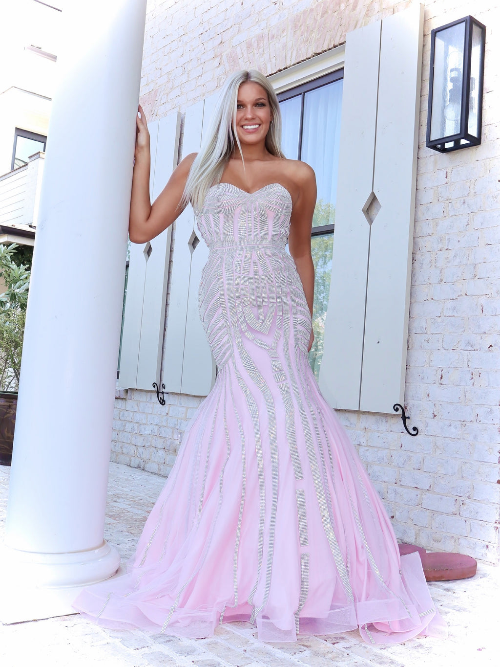 Blonde model in a Pink Sophisticated Mermaid with Sparkling Silver Details. And it's at Rsvp Prom and Pageant, your source for the HOTTEST Prom and Pageant Dresses and exclusive evening gowns and located in Atlanta, Georgia!