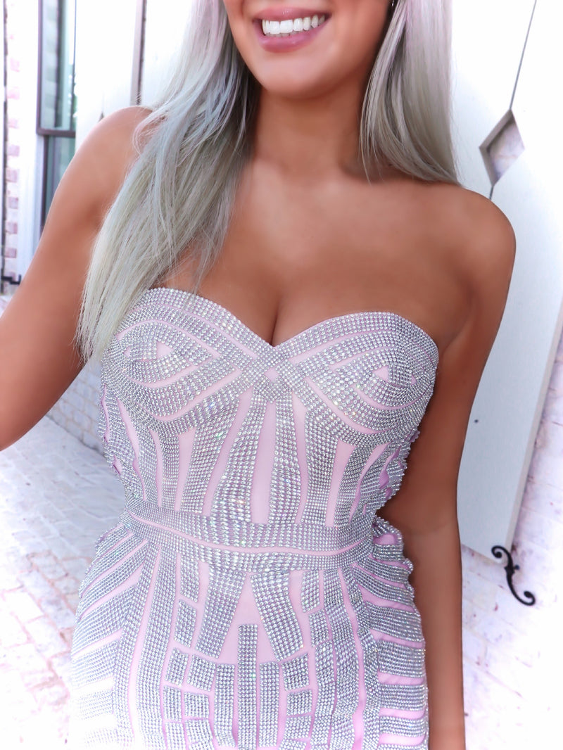 Closeup of Blonde model in a Pink Sophisticated Mermaid with Sparkling Silver Details. And it's at Rsvp Prom and Pageant, your source for the HOTTEST Prom and Pageant Dresses and exclusive evening gowns and located in Atlanta, Georgia