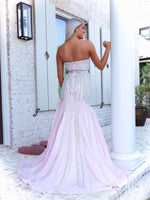 Back of Blonde model in a Pink Sophisticated Mermaid with Sparkling Silver Details. And it's at Rsvp Prom and Pageant, your source for the HOTTEST Prom and Pageant Dresses and exclusive evening gowns and located in Atlanta, Georgia