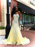 African American model looking absolutely stunning in this yellow mermaid evening gown with silver accents and a sweetheart neckline! The mermaid silhouette features a fully crinoline line skirt and a long train for drama! And it's at Rsvp Prom and Pageant, your source for the HOTTEST Prom and Pageant Dresses and exclusive evening gowns and located in Atlanta, Georgia!