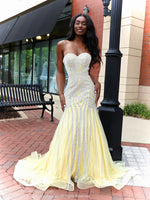 Beautiful African American model looking absolutely stunning in this yellow mermaid evening gown with silver accents and a sweetheart neckline! The mermaid silhouette features a fully crinoline line skirt and a long train for drama! And it's at Rsvp Prom and Pageant, your source for the HOTTEST Prom and Pageant Dresses and exclusive evening gowns and located in Atlanta, Georgia!