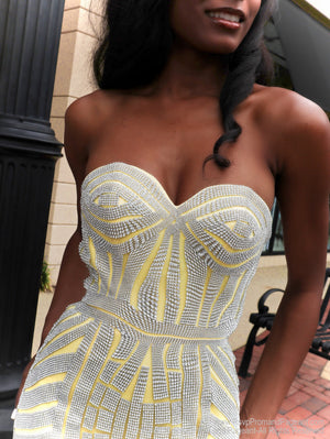 Closeup of African American model looking absolutely stunning in this yellow mermaid evening gown with silver accents and a sweetheart neckline! The mermaid silhouette features a fully crinoline line skirt and a long train for drama! And it's at Rsvp Prom and Pageant, your source for the HOTTEST Prom and Pageant Dresses and exclusive evening gowns and located in Atlanta, Georgia!