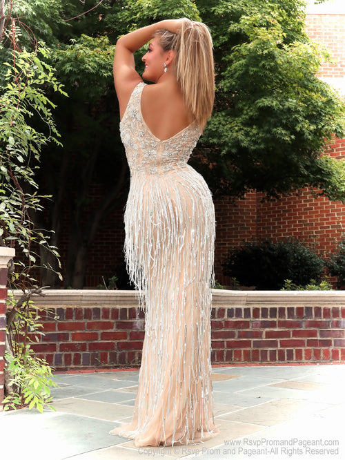 Back of Model feeling like a queen in this glamorous evening gown with a combination of silver beading, sequins and fun fringes! And it's at Rsvp Prom and Pageant, your source for the HOTTEST Prom and Pageant Dresses and Exclusive Evening Gowns and located in Atlanta, Georgia!