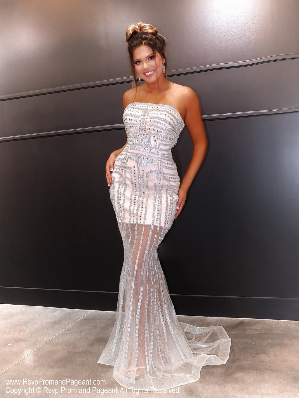 Model in a dazzling evening gown which has a sheer skirt and sparkling details all over! And it's at Rsvp Prom and Pageant, your source for the HOTTEST Prom and Pageant Dresses and exclusive evening gowns and located in Atlanta, Georgia!