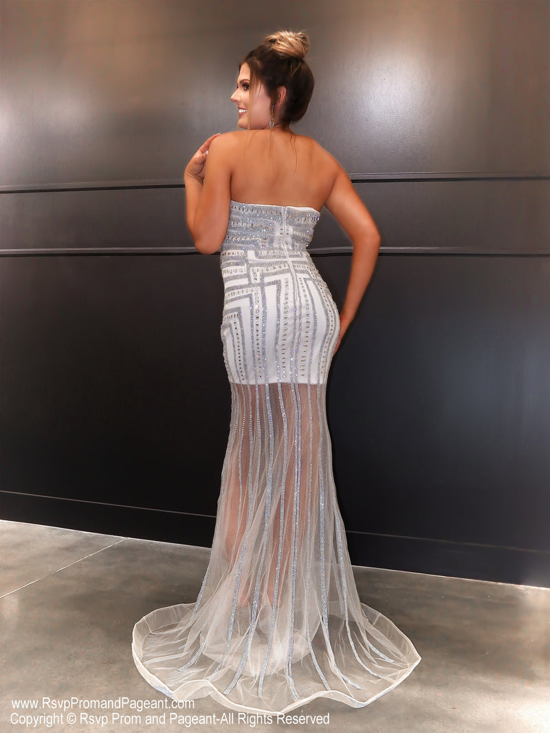 Back of Model in a dazzling evening gown which has a sheer skirt and sparkling details all over! And it's at Rsvp Prom and Pageant, your source for the HOTTEST Prom and Pageant Dresses and exclusive evening gowns and located in Atlanta, Georgia!