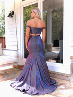 Back of Model in this STUNNING iridescent off the shoulder mermaid prom dress which will be the hit of the night! And its at RSVP Prom and Pageant,your source for the HOTTEST Prom and Pageant Dresses and Exclusive Evening Gowns and located in Atlanta, Georgia!.