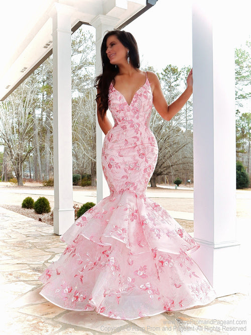 Model looking absolutely STUNNING in this couture gown featuring beautiful light pink lace applique! And it's at Rsvp Prom and Pageant, your source for the HOTTEST Prom and Pageant Dresses and Exclusive Evening Gowns and located in Atlanta, Georgia!