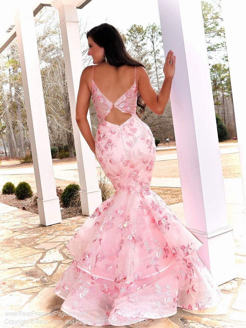 Back of Model looking absolutely STUNNING in this couture gown featuring beautiful light pink lace applique! And it's at Rsvp Prom and Pageant, your source for the HOTTEST Prom and Pageant Dresses and Exclusive Evening Gowns and located in Atlanta, Georgia!