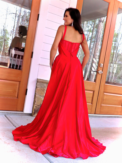 Back of model in this stunning sweetheart satin Ball Gown complete with a high slit and pockets! And its at RSVP Prom and Pageant, your source for the HOTTEST Prom and Pageant Dresses and Exclusive Evening Gowns and located in Atlanta, Georgia!