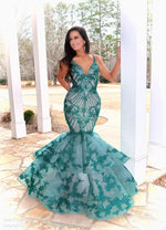 Model looking absolutely STUNNING in this couture gown featuring beautiful Emerald lace applique over nude! And it's at Rsvp Prom and Pageant, your source for the HOTTEST Prom and Pageant Dresses and Exclusive Evening Gowns and located in Atlanta, Georgia!