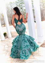 Back of Model looking absolutely STUNNING in this couture gown featuring beautiful Emerald lace applique over nude! And it's at Rsvp Prom and Pageant, your source for the HOTTEST Prom and Pageant Dresses and Exclusive Evening Gowns and located in Atlanta, Georgia!