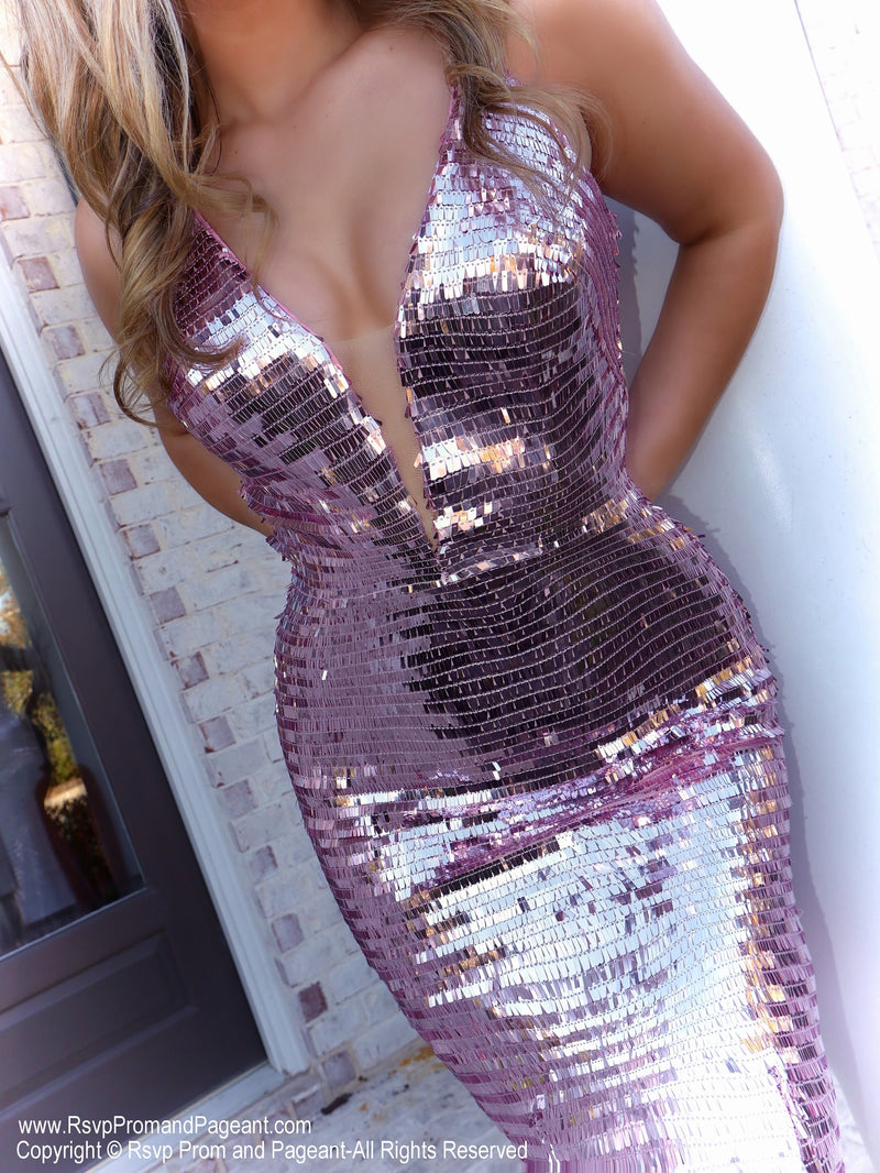 Closeup of Model in this fit and flair prom dress which is absolutely to die for with its pink sequins covered and a deep v-neckline. And it's at Rsvp Prom and Pageant, your source for the HOTTEST Prom and Pageant Dresses and Exclusive Evening Gowns and located in Atlanta, Georgia!