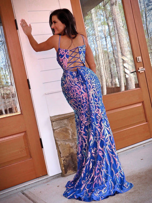 Back of in this purple sequin covered Prom Dress with an open, lace-up back and high slit! And it's at Rsvp Prom and Pageant, your source for the HOTTEST Prom and Pageant Dresses and Exclusive Evening Gowns and located in Atlanta, Georgia!