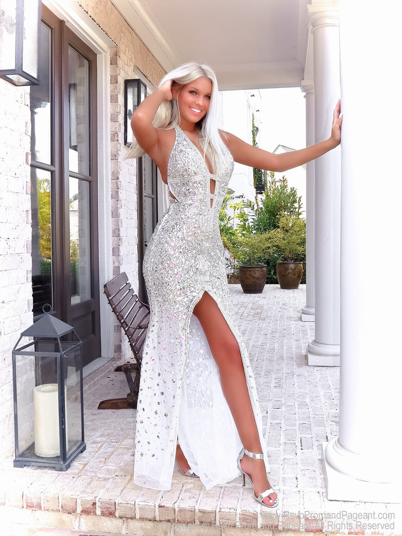 Pretty girl in this gorgeous evening gown fully detailed with iridescent stones! It also features a low cut back and a halter neckline! And it's at Rsvp Prom and Pageant, your source for the HOTTEST Prom, Pageant and evening gowns, Atlanta, Georgia!