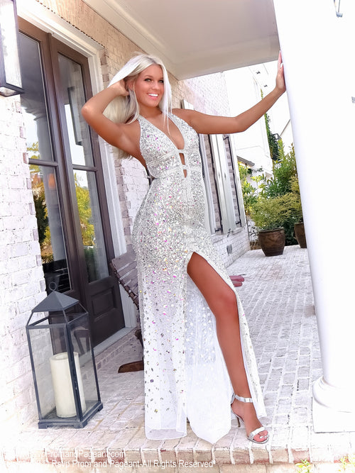 Beautiful blonde in this gorgeous evening gown fully detailed with iridescent stones! It also features a low cut back and a halter neckline! And it's at Rsvp Prom and Pageant, your source for the HOTTEST Prom, Pageant and evening gowns, Atlanta, Georgia!