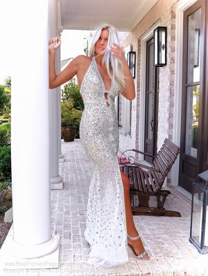 Pretty blonde in this gorgeous evening gown fully detailed with iridescent stones! It also features a low cut back and a halter neckline! And it's at Rsvp Prom and Pageant, your source for the HOTTEST Prom, Pageant and evening gowns, Atlanta, Georgia!