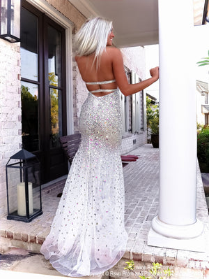 Back of model in this gorgeous evening gown fully detailed with iridescent stones! It also features a low cut back and a halter neckline! And it's at Rsvp Prom and Pageant, your source for the HOTTEST Prom, Pageant and evening gowns, Atlanta, Georgia!