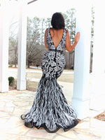 Floral, Feathers, and FABULOUS!! This flirty and fun, formfitting, mermaid, Black/White gown will for sure be the best dress at prom! And it's at Rsvp Prom and Pageant, your source for the HOTTEST Prom and Pageant Dresses and Exclusive Evening Gowns and located in Atlanta, Georgia!