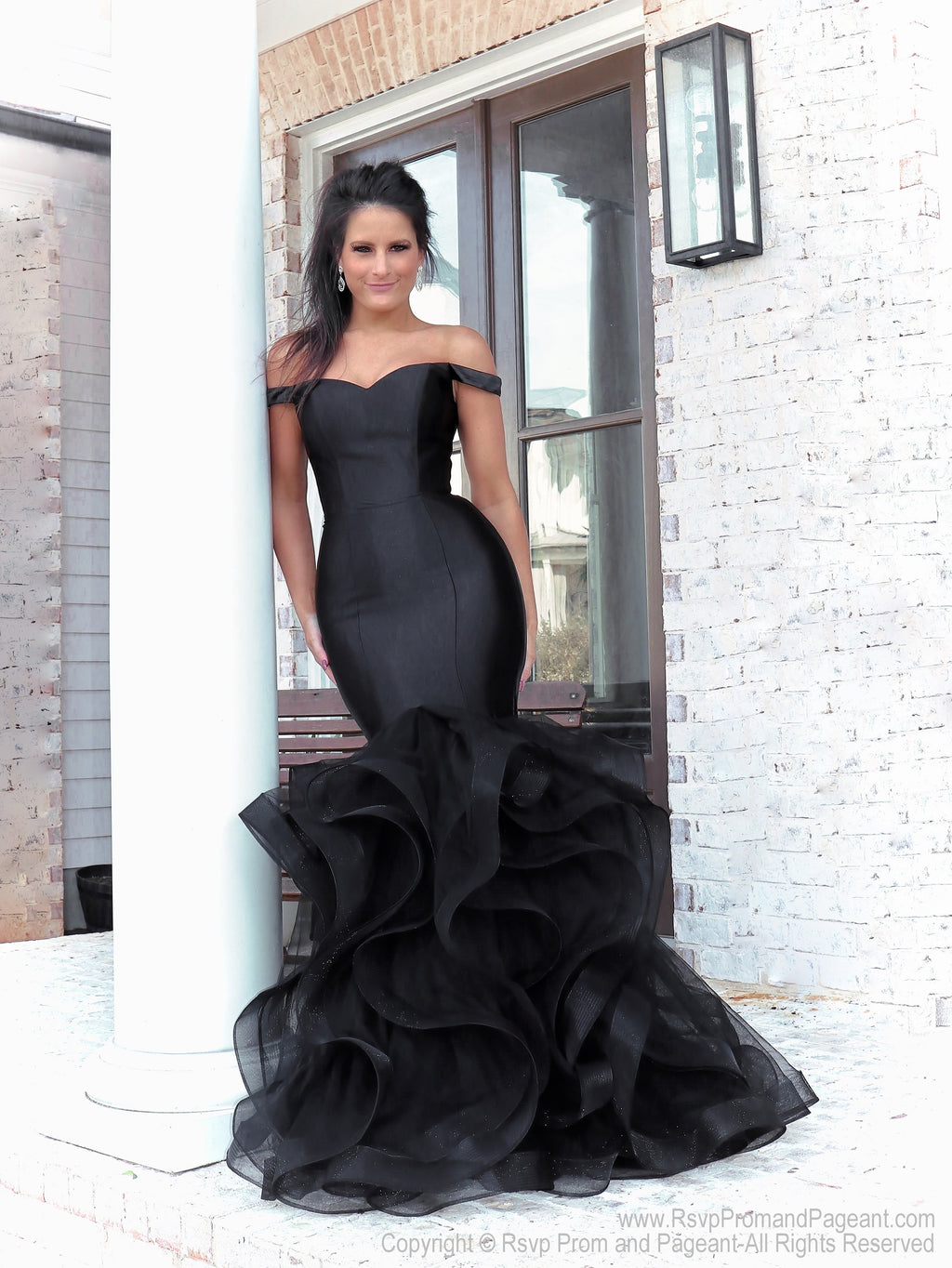 Beautiful model lacking nothing in style in this black off-the-shoulder evening gown with a super sophisticated mermaid silhouette! Perfect for ALL sizes up to size 22!! And it's at Rsvp Prom and Pageant, your source for the HOTTEST Prom and Pageant Dresses and exclusive evening gowns and located in Atlanta, Georgia!