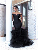 Brunette Beautiful model lacking nothing in style in this black off-the-shoulder evening gown with a super sophisticated mermaid silhouette! Perfect for ALL sizes up to size 22!! And it's at Rsvp Prom and Pageant, your source for the HOTTEST Prom and Pageant Dresses and exclusive evening gowns and located in Atlanta, Georgia!