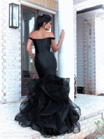 Back of Beautiful model lacking nothing in style in this black off-the-shoulder evening gown with a super sophisticated mermaid silhouette! Perfect for ALL sizes up to size 22!! And it's at Rsvp Prom and Pageant, your source for the HOTTEST Prom and Pageant Dresses and exclusive evening gowns and located in Atlanta, Georgia!