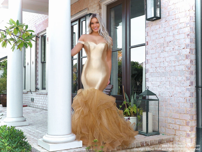 Beautiful lacking nothing in style in this gold off-the-shoulder evening gown with a super sophisticated mermaid silhouette! Perfect for ALL sizes up to size 22!! And it's at Rsvp Prom and Pageant, your source for the HOTTEST Prom and Pageant Dresses and exclusive evening gowns and located in Atlanta, Georgia!