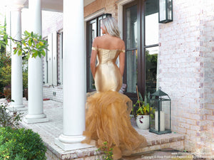Back of model lacking nothing in style in this gold off-the-shoulder evening gown with a super sophisticated mermaid silhouette! Perfect for ALL sizes up to size 22!! And it's at Rsvp Prom and Pageant, your source for the HOTTEST Prom and Pageant Dresses and exclusive evening gowns and located in Atlanta, Georgia!