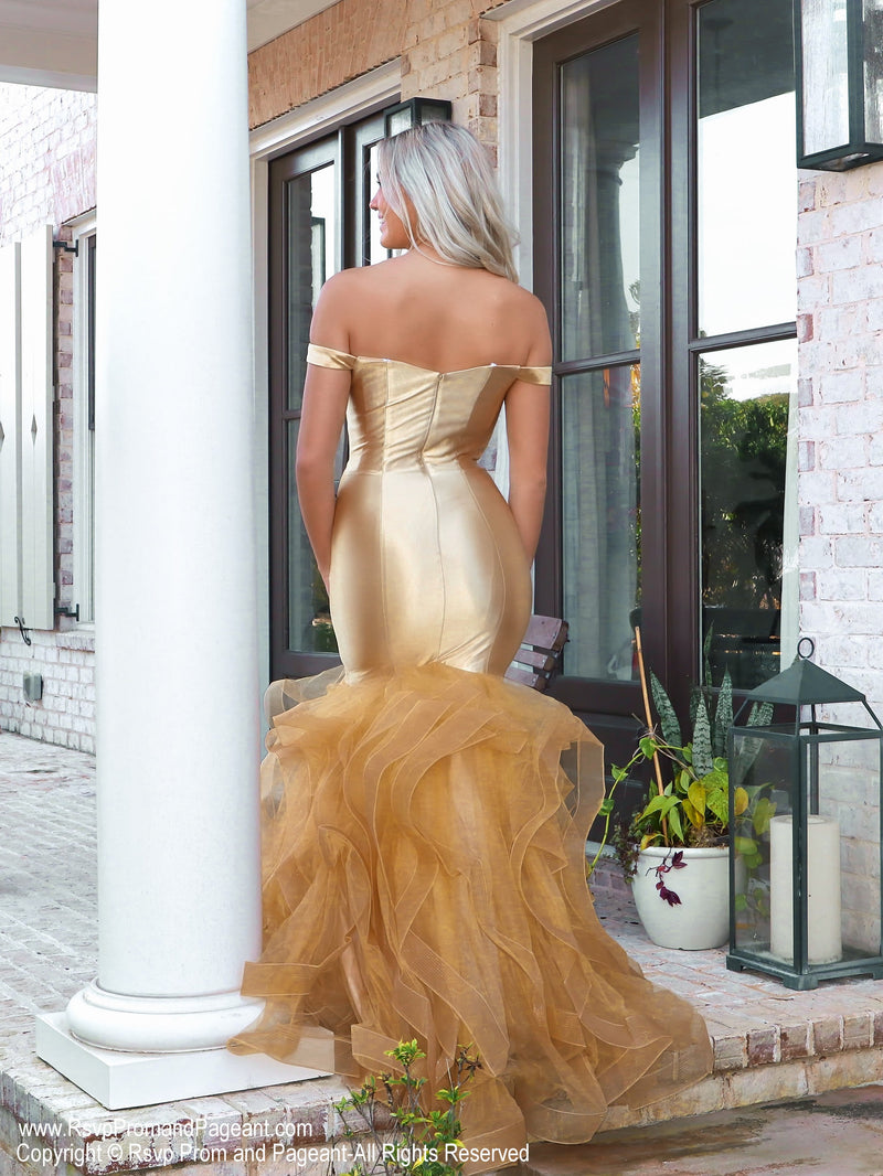 Back of beautiful lacking nothing in style in this gold off-the-shoulder evening gown with a super sophisticated mermaid silhouette! Perfect for ALL sizes up to size 22!! And it's at Rsvp Prom and Pageant, your source for the HOTTEST Prom and Pageant Dresses and exclusive evening gowns and located in Atlanta, Georgia!